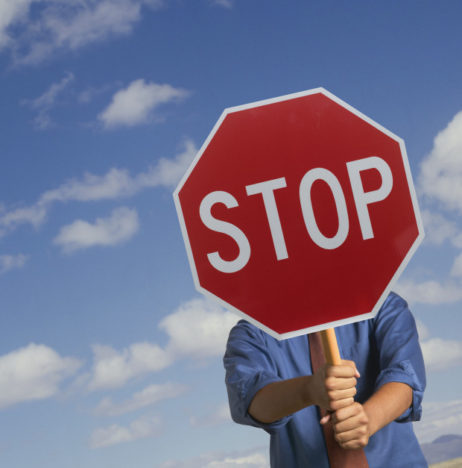 Man holding a stop signboard